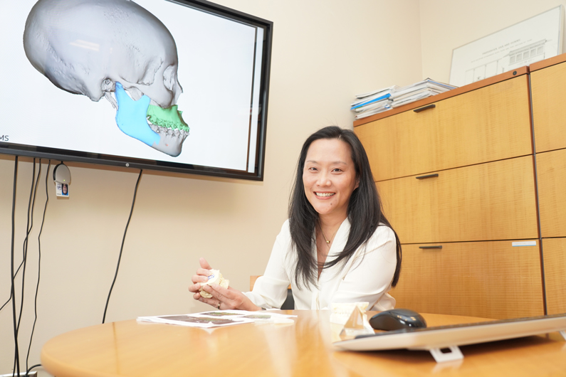 NIDCR Clinical Director Janice Lee sitting at desk