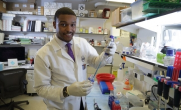 Photo of male African-American researcher in lab