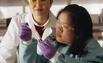 Two female scientists working in a lab
