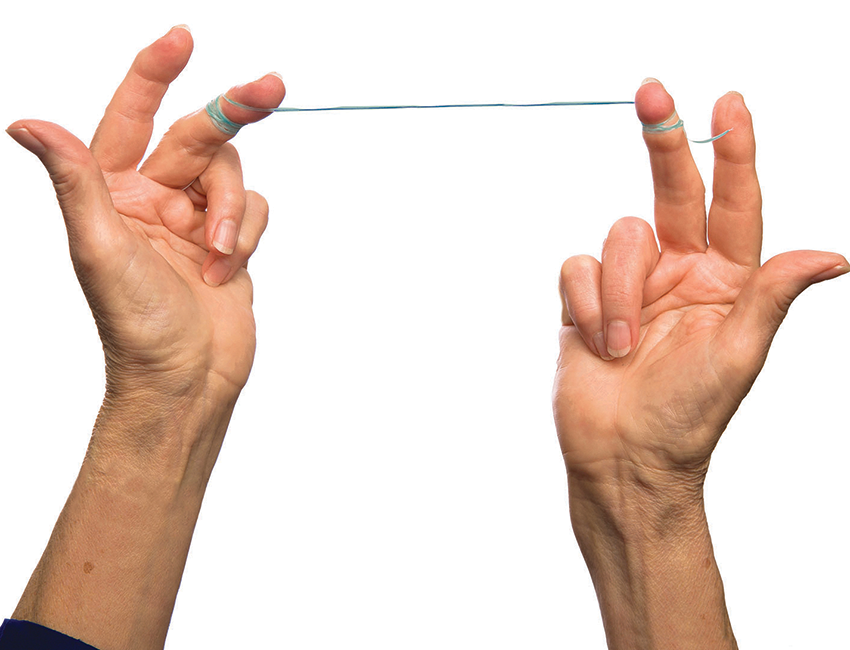 Use a string of floss about two feet long. Wrap it around the middle finger of each hand.