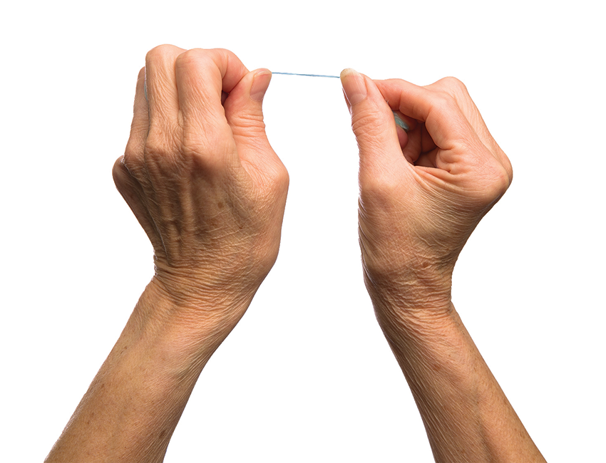 Grip the floss between the thumb and index finger of each hand.