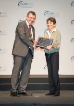 Dr. Martha Somerman receiving the IADR Distinguished Scientist Award in Basic Research in Biological Mineralization